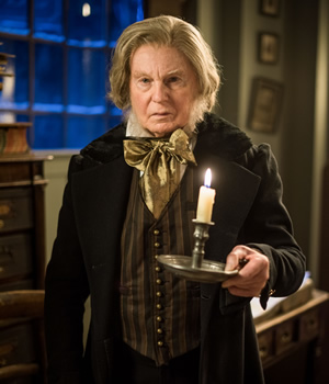 A Christmas Carol Goes Wrong. Scrooge (Derek Jacobi). Copyright: BBC.