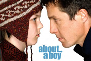 About A Boy. Image shows from L to R: Marcus (Nicholas Hoult), Will Freeman (Hugh Grant). Image credit: Working Title Films.
