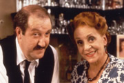 'Allo 'Allo!. Image shows from L to R: René François Artois (Gorden Kaye), Edith Melba Artois (Carmen Silvera). Image credit: British Broadcasting Corporation.