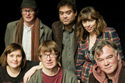 The Alternative Comedy Experience. Image shows from L to R: Josie Long, Simon Munnery, David Kay, Paul Sinha, Bridget Christie, Stewart Lee. Image credit: Comedy Central.
