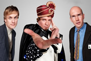 The Amazing Dermot. Image shows from L to R: Mickey (Darren Boyd), Dermot Flint (Rhys Darby), Neil (Alex Macqueen). Copyright: Roughcut Television.