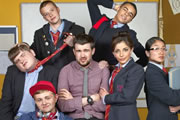 Bad Education. Image shows from L to R: Joe (Ethan Lawrence), Rem Dogg (Jack Binstead), Mitchell (Charlie Wernham), Alfie (Jack Whitehall), Stephen (Layton Williams), Chantelle (Nikki Runeckles), Jing (Kae Alexander). Copyright: Tiger Aspect Productions.