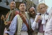 Captain Butler. Image shows from L to R: Cliff (Roger Griffiths), Captain Butler (Craig Charles), Adeel (Sanjeev Bhaskar), Roger (Lewis Rae). Image credit: Essential Film And Television Productions.