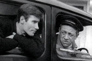 Carry On Cabby. Image shows from L to R: Jeremy (Jim Dale), Charlie Hawkins (Sidney James). Copyright: Anglo Amalgamated / Rank Organisation.