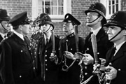 Carry On, Constable. Image shows from L to R: Sgt. Frank Wilkins (Sidney James), Inspector Mills (Eric Barker), Constable Benson (Kenneth Williams), Special Constable Timothy Gorse (Charles Hawtrey), Constable Tom Potter (Leslie Phillips), Constable Charlie Constable (Kenneth Connor). Copyright: Peter Rogers Productions.