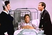 Carry On Doctor. Image shows from L to R: Matron (Hattie Jacques), Francis Bigger (Frankie Howerd), Dr. Tinkle (Kenneth Williams). Image credit: Peter Rogers Productions.
