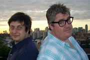 Comedy Exchange. Image shows from L to R: Eugene Mirman, Phill Jupitus. Copyright: Tiger Aspect Productions.