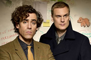Dirk Gently. Image shows from L to R: Dirk Gently (Stephen Mangan), Richard MacDuff (Darren Boyd). Image credit: ITV Studios.