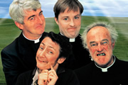 Father Ted. Image shows from L to R: Father Ted Crilly (Dermot Morgan), Mrs Doyle (Pauline McLynn), Father Dougal McGuire (Ardal O'Hanlon), Father Jack Hackett (Frank Kelly). Image credit: Hat Trick Productions.