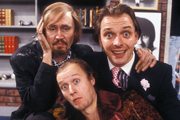 Filthy Rich & Catflap. Image shows from L to R: Ralph Filthy (Nigel Planer), Eddie Catflap (Adrian Edmondson), Richie Rich (Rik Mayall). Copyright: BBC.