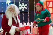 Get Santa. Image shows from L to R: Santa Claus (Jim Broadbent), Elf (Warwick Davis). Copyright: Scott Free Productions.
