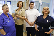 Getting On. Image shows from L to R: Nurse Kim Wilde (Jo Brand), Doctor Pippa Moore (Vicki Pepperdine), Hilary Loftus (Ricky Grover), Sister Den Flixter (Joanna Scanlan). Image credit: Vera Productions.