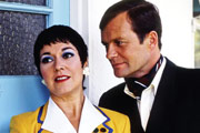 Hi-De-Hi!. Image shows from L to R: Gladys Pugh (Ruth Madoc), Sqdn-Ldr Clive Dempster DFC (David Griffin). Image credit: British Broadcasting Corporation.