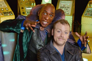 Hounded. Image shows from L to R: Dr Muhahahaha (Colin McFarlane), Rufus (Rufus Hound). Image credit: British Broadcasting Corporation.