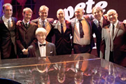 Pete And Dud: The Lost Sketches. Image shows from L to R: Alistair McGowan, Jonny Sweet, Pianist (Clifford Slapper), Hugh Dennis, Angus Deayton, Simon Day, Jonathan Ross, Adrian Edmondson. Copyright: Hot Sauce.