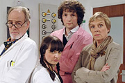 Lab Rats. Image shows from L to R: Professor John Mycroft (Geoff McGivern), Cara McIlvenny (Jo Enright), Dr Alex Beenyman (Chris Addison), Dean Mieke Miedema (Selina Cadell). Image credit: British Broadcasting Corporation.