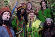 Maid Marian And Her Merry Men. Image shows from L to R: The Sheriff of Nottingham (Tony Robinson), Barrington (Danny John-Jules), Rabies (Howard Lew Lewis), Maid Marian (Kate Lonergan), Robin (Wayne Morris), Little Ron (Mike Edmonds). Image credit: British Broadcasting Corporation.