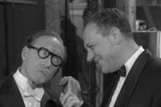 Make Mine A Million. Image shows from L to R: Arthur Ashton (Arthur Askey), Sid Gibson (Sid James). Image credit: Jack Hylton Film Productions.