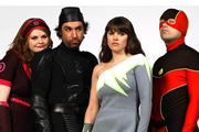 No Heroics. Image shows from L to R: Jenny, aka She-Force (Rebekah Staton), Don, aka Timebomb (James Lance), Sarah, aka Electroclash (Claire Keelan), Alex, aka The Hotness (Nicholas Burns). Image credit: Tiger Aspect Productions.