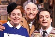 Open All Hours. Image shows from L to R: Nurse Gladys Emmanuel (Lynda Baron), Albert Arkwright (Ronnie Barker), Granville (David Jason). Image credit: British Broadcasting Corporation.