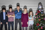 Outnumbered. Image shows from L to R: Ben (Daniel Roche), Jake (Tyger Drew-Honey), Pete (Hugh Dennis), Sue (Claire Skinner), Karen (Ramona Marquez). Copyright: Hat Trick Productions.