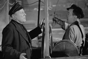 Penny Paradise. Image shows from L to R: Captain Joe Higgins (Edmund Gwenn), Pat (Jimmy O'Dea). Copyright: Associated Talking Pictures.
