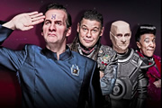 Red Dwarf. Image shows from L to R: Rimmer (Chris Barrie), Lister (Craig Charles), Kryten (Robert Llewellyn), Cat (Danny John-Jules). Copyright: Grant Naylor Productions / BBC.