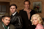 Rock & Chips. Image shows from L to R: Edward 'Ted' Trotter (Phil Daniels), Del Boy (James Buckley), Reg Trotter (Shaun Dingwall), Joan Trotter (Kellie Bright). Copyright: Shazam Productions / BBC.