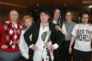 Star Stories. Image shows from L to R: Phil Collins (Trevor Lock), Simon Le Bon (Fergus Craig), Bono (Harry Peacock), Boy George (Steve Edge), Midge Ure (Tom Basden), Bob Geldof (Fergus Craig). Copyright: Objective Productions.