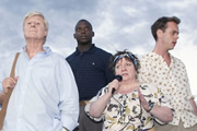 Taking The Flak. Image shows from L to R: David Bradburn (Martin Jarvis), Joyful Sifuri (Kobna Holdbrook-Smith), Margaret Hollis (Joanna Brookes), Harry Chambers (Bruce Mackinnon). Copyright: BBC.