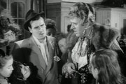 The Belles Of St. Trinian's. Image shows from L to R: Flash Harry (George Cole), Miss Millicent Fritton (Alastair Sim). Image credit: London Films.