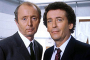 The Detectives. Image shows from L to R: Bob Louis (Jasper Carrott), Dave Briggs (Robert Powell). Image credit: Celador Productions.
