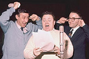 The Goon Show. Image shows from L to R: Count Jim Moriarty (Spike Milligan), Neddie Seagoon (Harry Secombe), Hercules Grytpype-Thynne (Peter Sellers). Image credit: British Broadcasting Corporation.