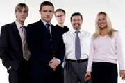 The Office. Image shows from L to R: Gareth Keenan (Mackenzie Crook), Tim Canterbury (Martin Freeman), Stephen Merchant, David Brent (Ricky Gervais), Dawn Tinsley (Lucy Davis). Image credit: British Broadcasting Corporation.