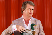 Paul Merton writing a book
