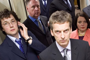 The Thick Of It. Image shows from L to R: Oliver Reeder (Chris Addison), Glenn Cullen (James Smith), Malcolm Tucker (Peter Capaldi), Terri Coverley (Joanna Scanlan). Image credit: British Broadcasting Corporation.