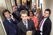 The Thick Of It. Image shows from L to R: Oliver Reeder (Chris Addison), Glenn Cullen (James Smith), Malcolm Tucker (Peter Capaldi), Terri Coverley (Joanna Scanlan), Robyn Murdoch (Polly Kemp), Jamie (Paul Higgins). Copyright: BBC.