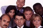 The Thin Blue Line. Image shows from L to R: D.I. Grim (David Haig), P.C. Habib (Mina Anwar), Inspector Fowler (Rowan Atkinson), P.C. Goody (James Dreyfus), D.C. Boyle (Mark Addy), Sergeant Dawkins (Serena Evans), P.C. Gladstone (Rudolph Walker). Copyright: Tiger Aspect Productions.