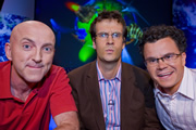 The What In The World? Quiz. Image shows from L to R: Lee Hurst, Marcus Brigstocke, Dominic Holland. Image credit: Shine.
