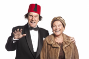Tommy Cooper: Not Like That, Like This. Image shows from L to R: Tommy Cooper (David Threlfall), Dove Cooper (Amanda Redman). Image credit: Left Bank Pictures.