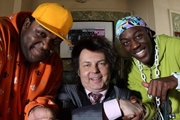 Trexx And Flipside. Image shows from L to R: Trexx (Peter Dalton), Mr Brilliance (Rich Fulcher), Flipside (David Ajala). Copyright: Hanrahan Media.