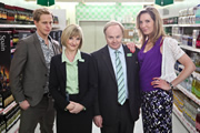 Trollied. Image shows from L to R: Richard (Chris Geere), Julie (Jane Horrocks), Gavin (Jason Watkins), Anna (Elizabeth Bower). Image credit: Roughcut Television.
