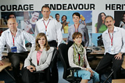 Twenty Twelve. Image shows from L to R: Nick Jowett (Vincent Franklin), Siobhan Sharpe (Jessica Hynes), Ian Fletcher (Hugh Bonneville), Sally Owen (Olivia Colman), Kay Hope (Amelia Bullmore), Graham Hitchins (Karl Theobald). Copyright: BBC.