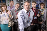 Twenty Twelve. Image shows from L to R: Siobhan Sharpe (Jessica Hynes), Nick Jowett (Vincent Franklin), Graham Hitchins (Karl Theobald), Ian Fletcher (Hugh Bonneville), Daniel Stroud (Samuel Barnett), Kay Hope (Amelia Bullmore). Image credit: British Broadcasting Corporation.