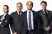 Yes, Prime Minister. Image shows from L to R: Claire Sutton (Zoe Telford), Sir Humphrey Appleby (Henry Goodman), Jim Hacker (David Haig), Bernard Woolley (Chris Larkin). Image credit: British Broadcasting Corporation.