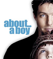 About A Boy. Image shows from L to R: Will Freeman (Hugh Grant), Marcus (Nicholas Hoult). Image credit: Working Title Films.