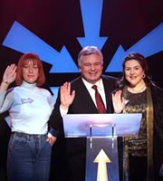 Anna & Katy. Image shows from L to R: Anna Crilly, Eamonn Holmes, Katy Wix. Image credit: Roughcut Television.