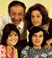 Bless This House. Image shows from L to R: Sally Abbott (Sally Geeson), Sid Abbott (Sid James), Mike Abbott (Robin Stewart), Jean Abbott (Diana Coupland). Image credit: Thames Television.