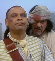 Captain Butler. Image shows from L to R: Captain Butler (Craig Charles), Bosun (Shaun Curry). Image credit: Essential Film And Television Productions.