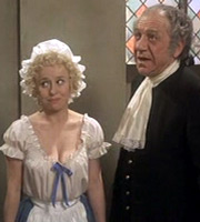 Carry On Dick. Image shows from L to R: Harriet (Barbara Windsor), Richard 'Big Dick' Turpin / Reverend Flasher (Sidney James). Image credit: Peter Rogers Productions.